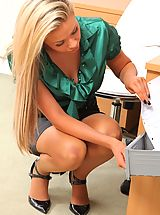 Beautiful blonde secretary teases her way out of her silk blouse and tight pencil skirt.