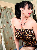 Naughty America Pics: Brunette cougar has her way with a young cock.