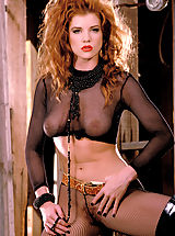 lingerie model, Julia Hayes gets kinky with see through stockings and fishnets and her fiery hair gone wild!