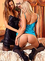 Eufrat and Michelle M slowly undress each other and tease each other with their perfect bodies in just stockings and heels.