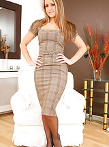 Beautiful blonde in smart checkered dress and light lingerie. Non Nude