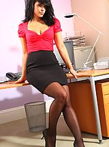 Raven haired stunner in a low cut red top and black pencil skirt.