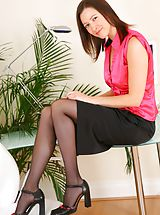 Carole looking stunning in satin top and tight skirt. Non Nude