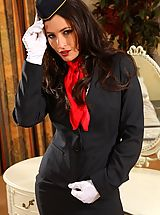 Gorgeous dark haired air hostess teases in her tight skirt suit before stripping down to her panties