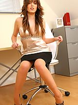 Brunette Ashley strips from her naughty secretary outfit.