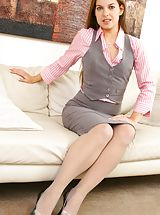 Naughty Office, Michaela in cute pink and grey work outfit.