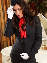 Gorgeous dark haired air hostess teases in her tight skirt suit before stripping down to her panties, stockings and heels.