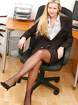 Secretary Pics: Breathtaking blonde secretary in smart black skirt suit.