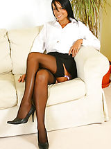 Sultry Sophie in secretary outfit with black stockings