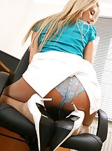 Breathtaking blonde teases her way out of the satin blouse and knee length skirt. Non Nude