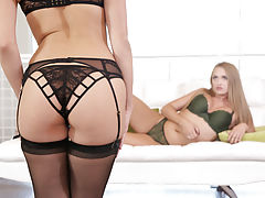 Jenna Sativa walks in on Kandace Kayne as the blonde is fondling her big boobs and slipping a hand down to her thong-clad landing strip pussy.