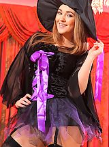 Cute, curvy blonde strips out of her halloween costume and looks a treat in her lilac lingerie and black stockings.