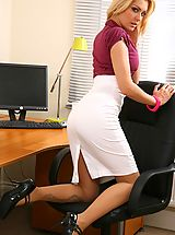 Blonde looks stunning in her office wearing a tight blouse and a tight long white skirt.